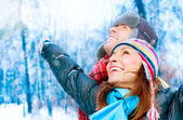 Happy Young Couple in Winter Park having fun.Family Outdoors — Zdjęcie stockowe