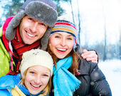 Family Outdoors.Happy Family with kid blowing Snow.Winter — Stock Photo