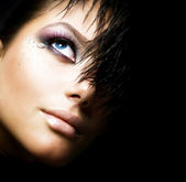 Fashion Girl's Face. Perfect makeup. Isolated on Black — Stock Photo