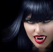 Halloween Vampire Beautiful Woman over black — Stock Photo
