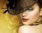 Fashion Beautiful Woman Over luxury Gold Background — Stock Photo