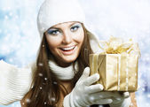Beautiful Happy Girl with Christmas Gift. Snow — Stock Photo