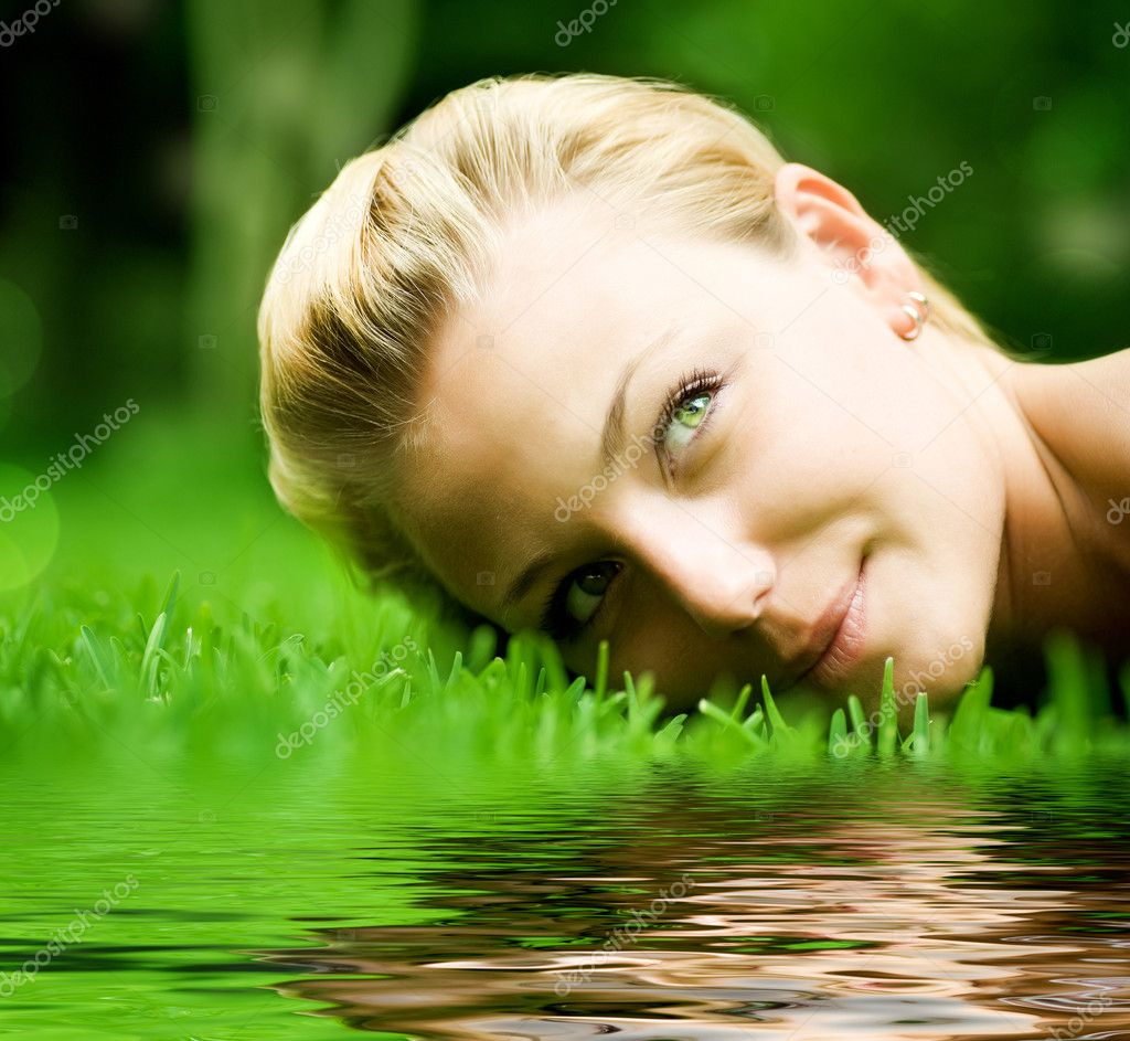 Beautiful Girl Lying On The Grass — Stock Photo #10603799