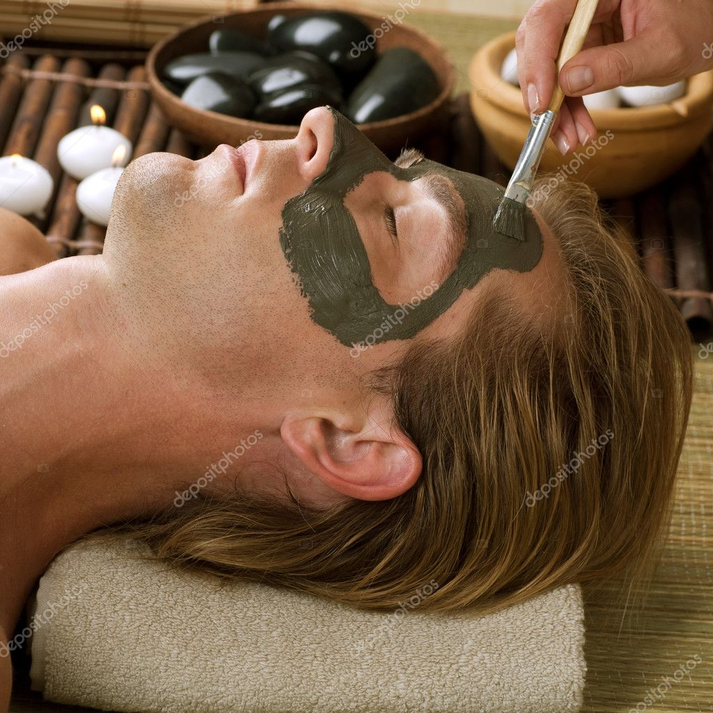 Spa. Handsome Man With A Mud Mask On His Face — Stock Photo #10604933