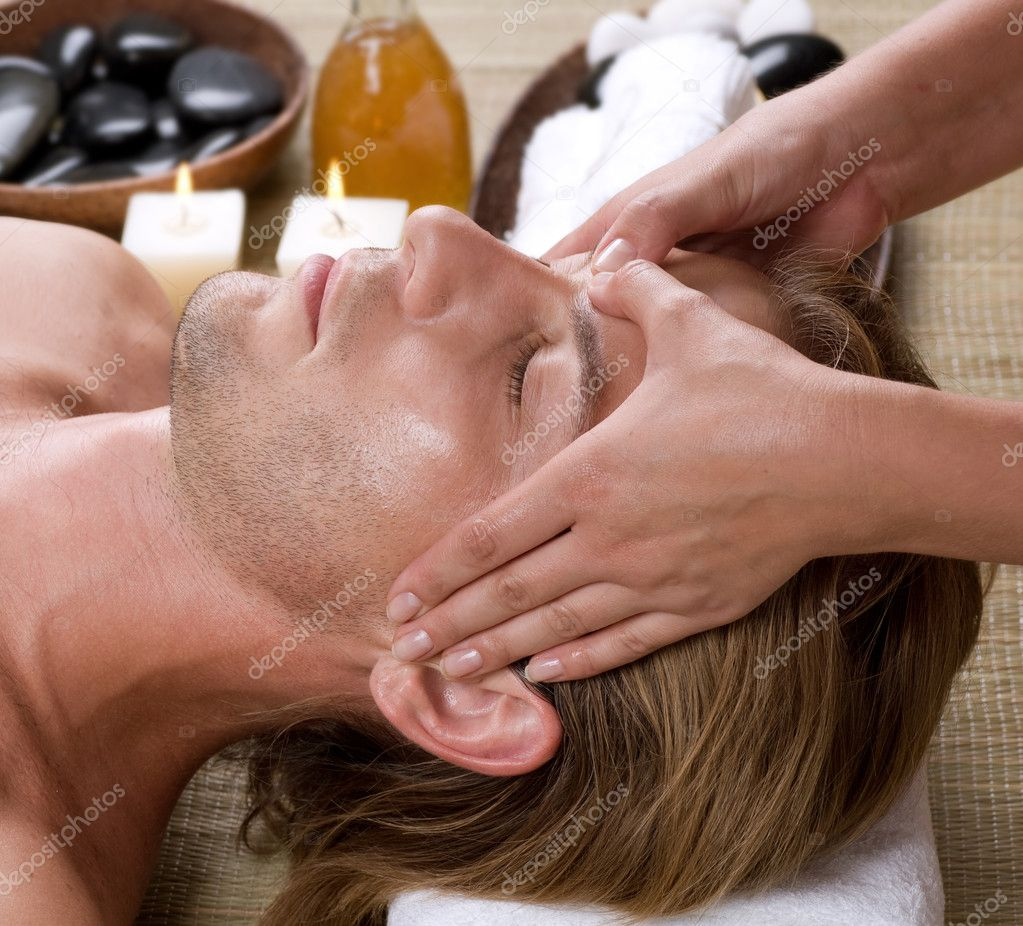 Spa young man getting face massage stock photo for Salon younga