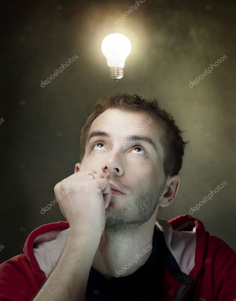 Young Man Having An Idea. Light Bulb Above His Head — Stock Photo #10604970