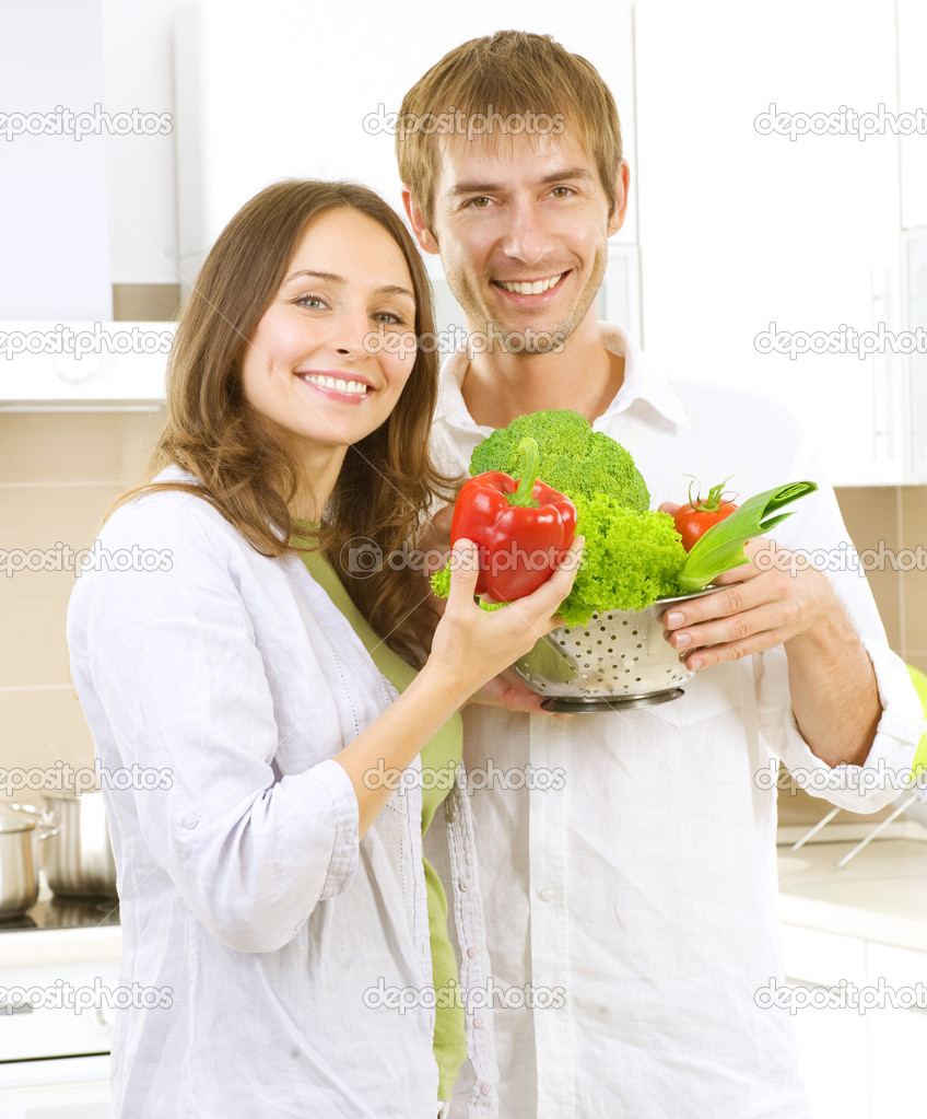 Young Couple Cooking Healthy food.Diet.Kitchen  Stock Photo #10605100