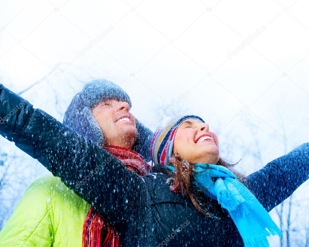 Happy Young Couple in Winter Park having fun.Family Outdoors — Stock Photo #10605145