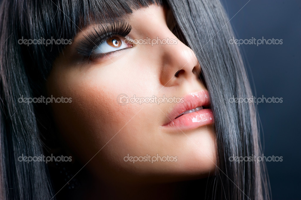 Fashion Brunette . Beautiful Makeup and Healthy Black Hair  Stock Photo #10605630