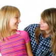 Stock Photo: Happy Teen Friends over white.Teenage Girls.Friendship