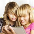 Teenage girls using touchpad. PC tablet — Stock Photo #10676011
