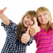 Portrait of happy teen girls showing thumbs up isolated one whit — Stock Photo #10676020