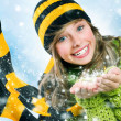 Christmas Girl.Winter Teenage girl Blowing Snow .New Year celebr — Stock Photo