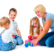 Stock Photo: Children playing on the floor with Teacher.Happy kids.Education.