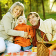Happy Family in a Park. Picnic — Stock Photo #10676154