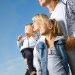 Stock Photo: Healthy Family Outdoor. Happy Mother And Father With Kids Over B