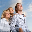 Stock Photo: Healthy Family Outdoor. Happy Mother And Father With Kid Over Bl