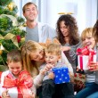 Happy Big family holding Christmas presents at home.Christmas tr — Φωτογραφία Αρχείου
