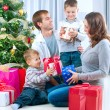 Zdjęcie stockowe: Happy Big family holding Christmas presents at home.Christmas tr