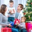 Happy Big family holding Christmas presents at home.Christmas tr — Stok fotoğraf