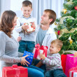 Stockfoto: Happy Big family holding Christmas presents at home.Christmas tr