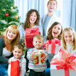Happy Big family holding Christmas presents at home.Christmas tr — 图库照片