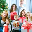 Happy Big family holding Christmas presents at home.Christmas tr — Stock fotografie #10676258