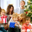 Happy Big family holding Christmas presents at home.Christmas tr - Stock Photo