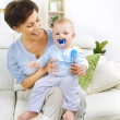 Happy Mother playing with Baby — Stock Photo #10676339