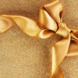 Holiday Background.Greeting Card.Gold Bow on a Blinking Backgrou — Stock Photo