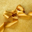 Gold Ribbon Bow on a Blinking Background Holiday Background.Gree — Stock Photo