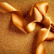 Stock Photo: Holiday Background.Greeting Card.Gold Bow on a Blinking Backgrou