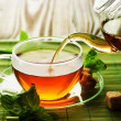 Pouring Herbal Tea - Stock Photo