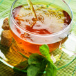Pouring Healthy Tea — Stock Photo #10677412