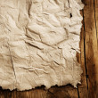 Old Paper sheet over wooden background closeup — Stock Photo #10677489