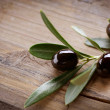 Olive over Wood Background — Stock Photo #10677604