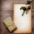 Handmade Olive Soap and Blank Paper with Olive Branch over Woode — Stock Photo