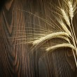 Stock Photo: Wheat Border Over Wooden Background