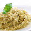 Italian Pasta With Pesto Sauce, Basil And Parmesan Cheese — Stock Photo #10678592