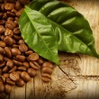 Coffee Beans over Wood Background — Stock Photo #10679868