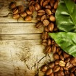 Coffee Beans over Wood Background — Stock Photo #10679875