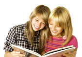 Two Teenage Girls reading The Book.Education — Stock Photo