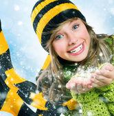 Christmas Girl.Winter Teenage girl Blowing Snow .New Year celebr — Stock Photo