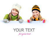 Beautiful Teenage Girls holding blank sign billboard. Space for — Stock Photo
