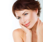 Beautiful Young Woman touching her Face. Skincare .Perfect Skin — Stock Photo