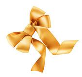 Bow. Golden satin gift bow. Ribbon. Isolated on white — Stock Photo
