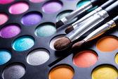 Makeup brushes and make-up eye shadows — Stock Photo