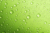 Water drops over green. Closeup — Stock Photo