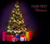 Christmas Tree with Gifts isolated on black — Stock Photo