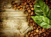 Coffee Beans over Wood Background — Stock Photo